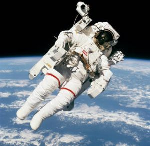 Astronaut Bruce McCandless II, STS-41B mission specialist, uses his hands to control his movement above the Earth - and just few meters away from the space shuttle Challenger during the first ever untethered spacewalk. Image: NASA