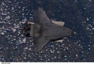 This underside view of the Space Shuttle Discovery was photographed by Expedition 11 Commander Sergei K. Krikalev and NASA Space Station Science Officer John Phillips as Discovery approached the International Space Station and performed a backflip to inspect the shuttles Thermal Protection System. Image: NASA
