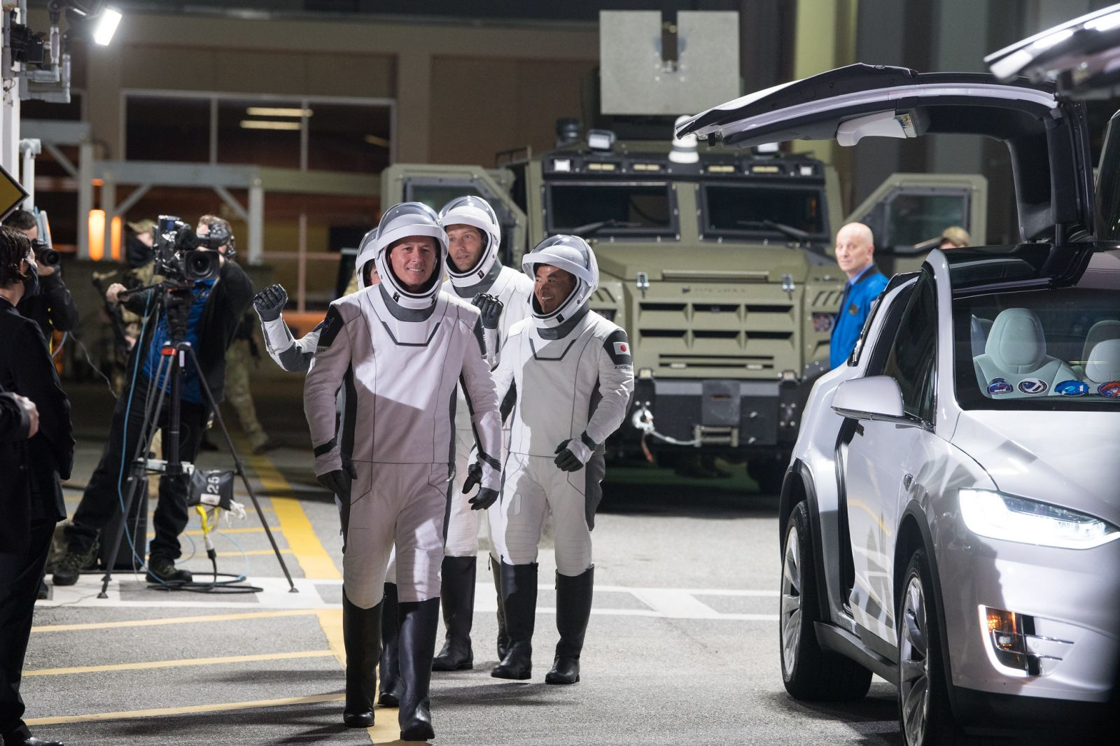 The Crew-2 astronauts board two Tesla Model X electric vehicles for their trip to the launch pad. Credit: NASA