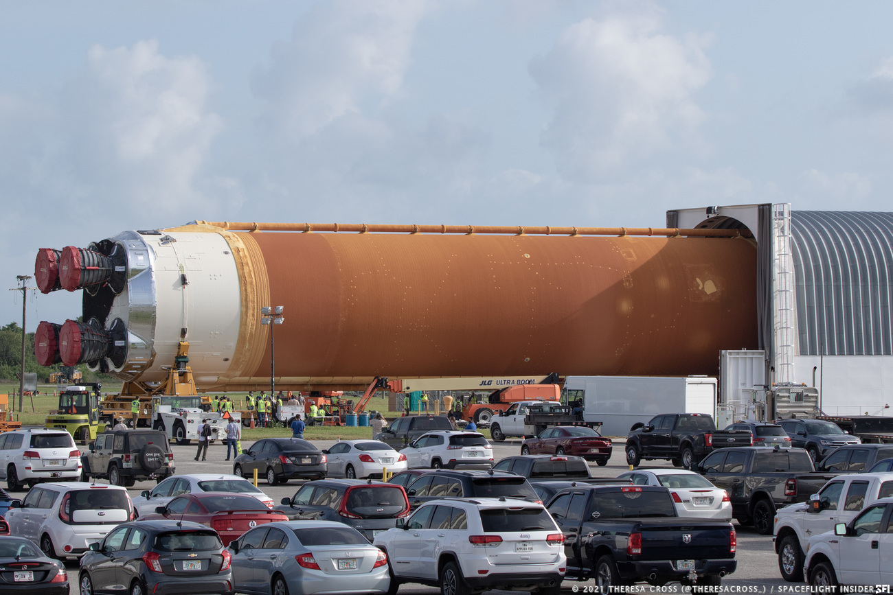 The core stage for the first Space Launch System rocket is moved out of the Pegasus barge for transport to the Vehicle Assembly Building. Credit: Theresa Cross / Spaceflight Insider