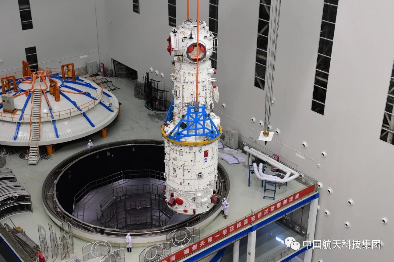 The Tianhe module undergoing testing before launch. For scale, there is a person next to its base. Credit: China Aerospace Science and Technology Corporation