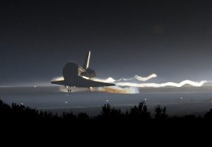 Space shuttle Atlantis (STS-135) touches down at NASA's Kennedy Space Center Shuttle Landing Facility (SLF), completing its 13-day mission to the International Space Station (ISS) and the final flight of the Space Shuttle Program, early Thursday morning, July 21, 2011, in Cape Canaveral, Fla. Image: NASA