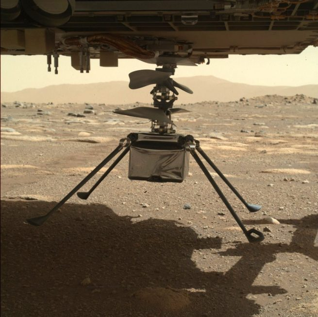 Ingenuity fully extended underneath the rover before its final deployment onto the surface of Mars. Credit: NASA
