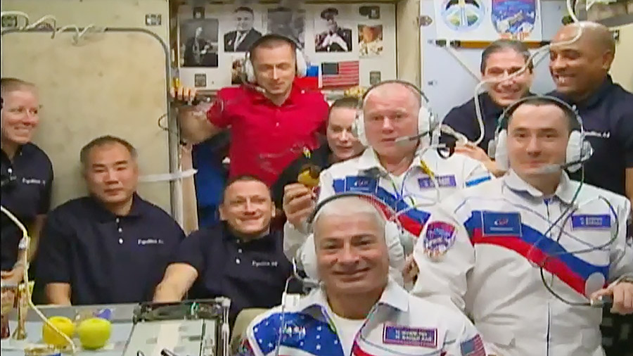 After docking, the three new members joined with the seven already aboard the outpost in the Zvezda service module for a welcome ceremony. Credit: NASA