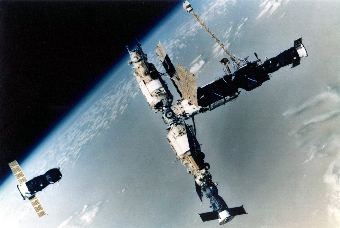 A view of the Mir space station in July 1993. On the left is Progress M-17. On the bottom is Soyuz TM-16. The photo was captured by the crew of Soyuz TM-17, which would dock at the port that Progress M-18, left, was vacating within a half hour of its departure. Credit: Roscosmos