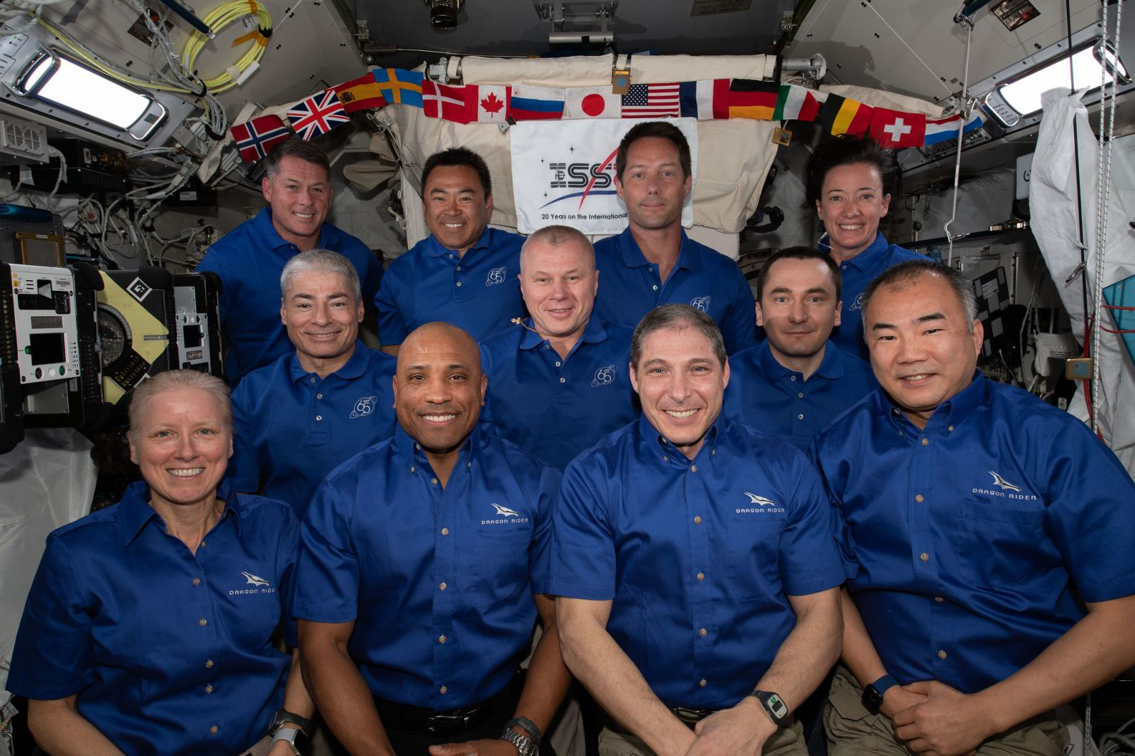 The 11 people aboard the International Space Station between the arrival of Crew-2 Dragon and the departure of Crew-1 Dragon. The Crew-1 astronauts are in the front row. Credit: NASA