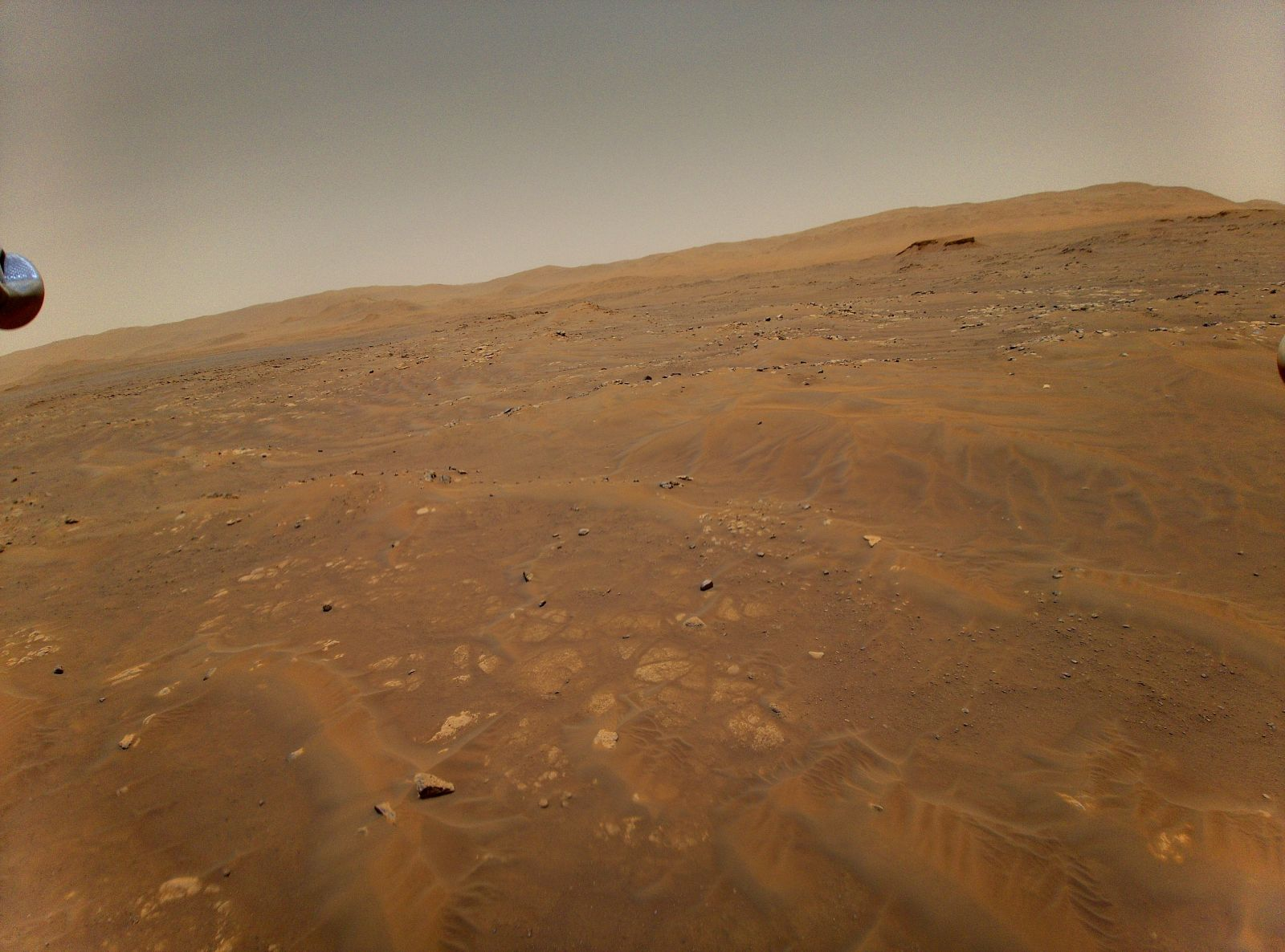 The onboard color camera on the Ingenuity Mars Helicopter captures this image of the horizon as it experiences large oscillations during the latter part of its sixth flight on Mars. Nonetheless, the helicopter landed safely within 15 feet of its intended location. Credit: NASA/JPL-Caltech