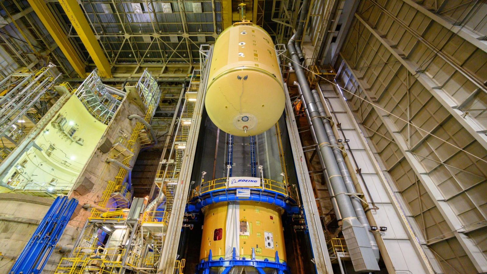 The Artemis 2 Space Launch System core stage liquid oxygen tank is readied for attachment to the interstage at NASA's Michoud Assembly Facility in New Orleans. Credit: NASA