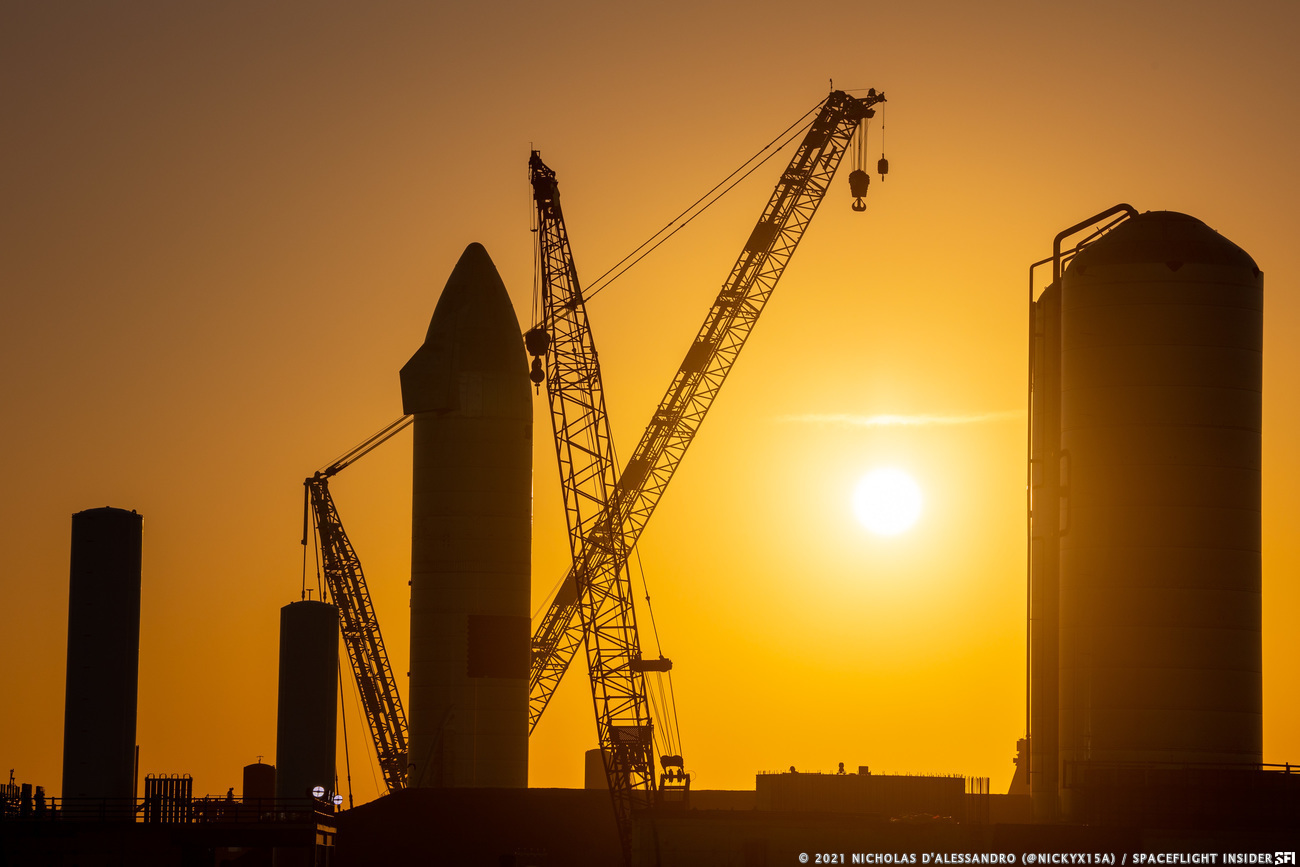 A view of cranes around the landed Starship SN15 at sunset. Credit: Nicholas D'Alessandro / Spaceflight Insider