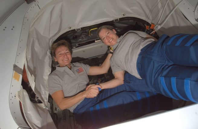 Pam Melroy, right, shakes hands with Peggy Whitson aboard the International Space Station in October 2007 as commander of space shuttle mission STS-120 and International Space Station Expedition 16, respectively. Credit: NASA