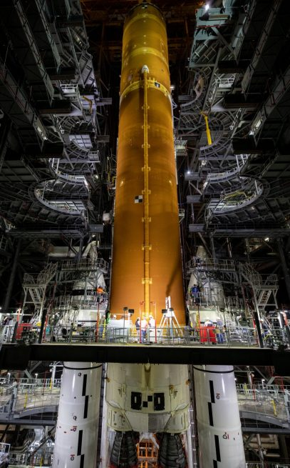 The SLS core is lowered between the two five-segment solid rocket boosters in High Bay 3. Credit: NASA