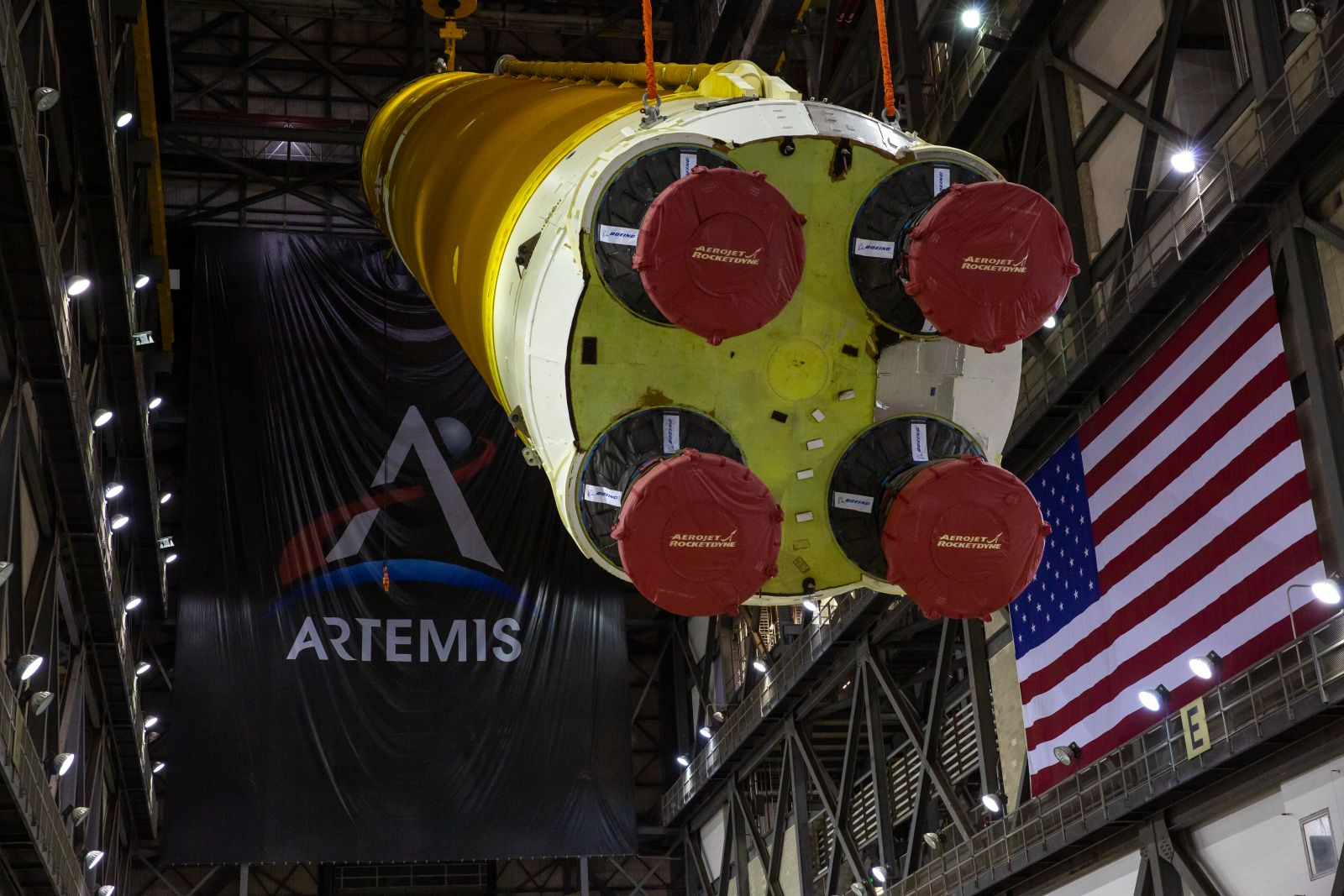 The first SLS core stage is lifted in the Vehicle Assembly Building's transfer aisle. Credit: NASA