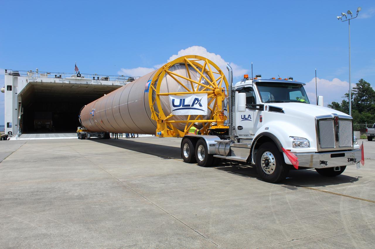 A United Launch Alliance Atlas V booster for Boeing's CST-100 Starliner Crew Flight Test is loaded onto a rocket-delivery ship at ULA's manufacturing factory in Decatur, Alabama, on June 11, 2021, in preparation for its journey to Cape Canaveral. Credit: ULA