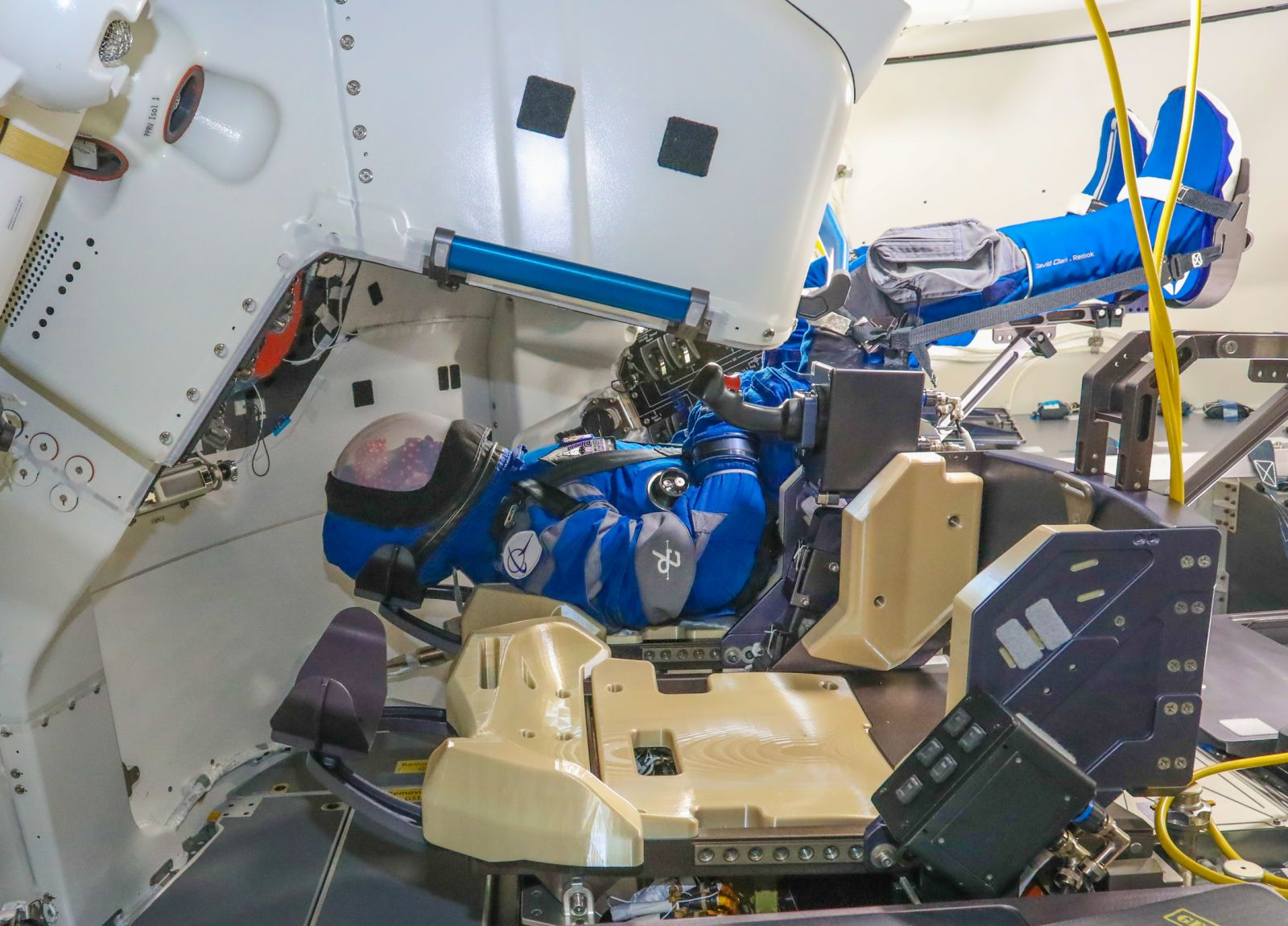 """The anthropometric test device, named """"Rosie the Rocketeer,"""" is positioned in the commander's seat for the OFT-2 mission. Credit: Boeing"""
