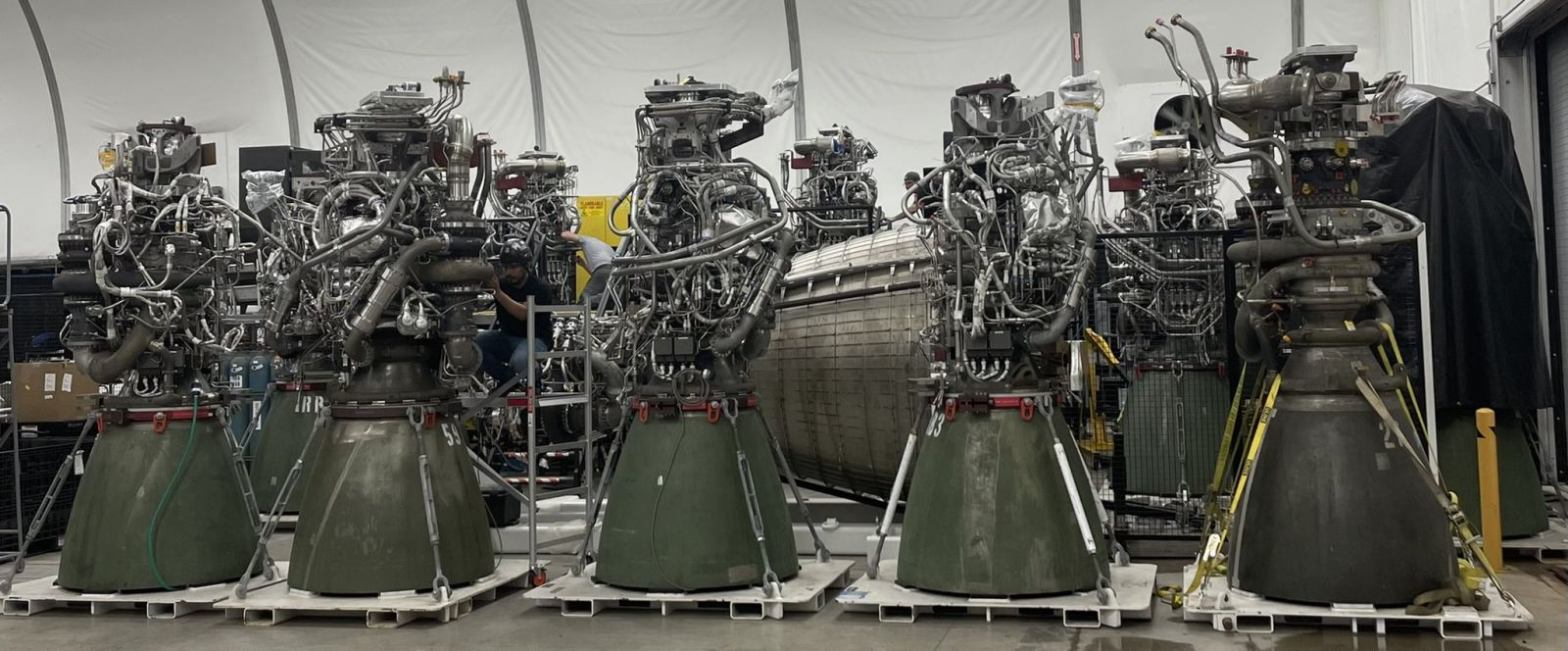 Fellowship of the Raptors: Nine sea level Raptor engines and one Raptor Vacuum engine at SpaceX's Starbase facility in South Texas. Credit: Elon Musk / SpaceX