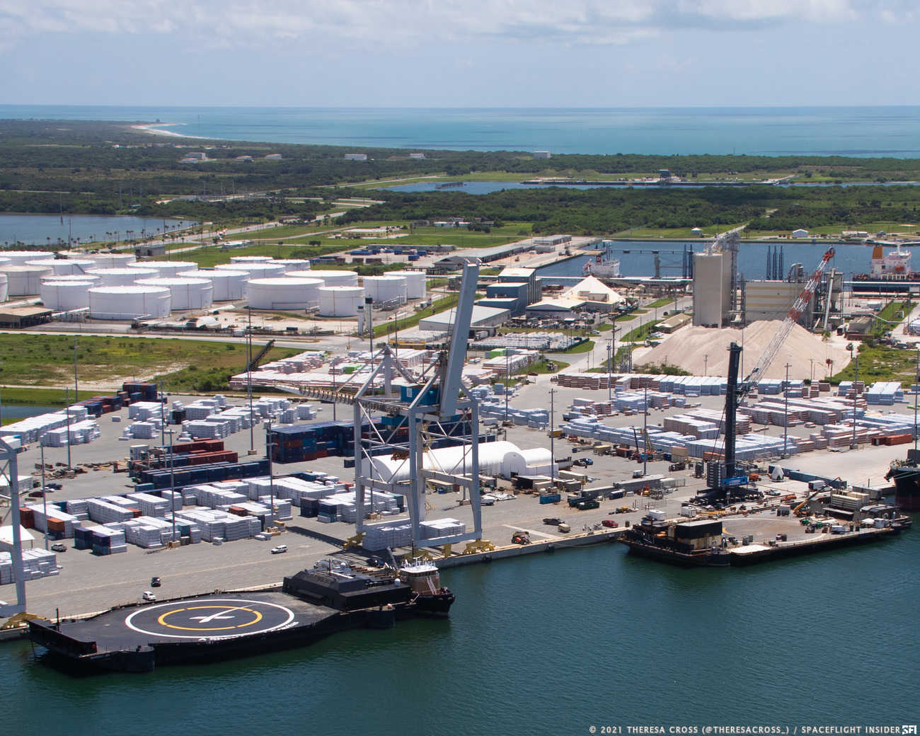"""""""A Shortfall of Gravitas"""" next to """"Just Read the Instructions"""" at a wharf at Port Canaveral. Credit: Thresa Cross / Spaceflight Insider"""