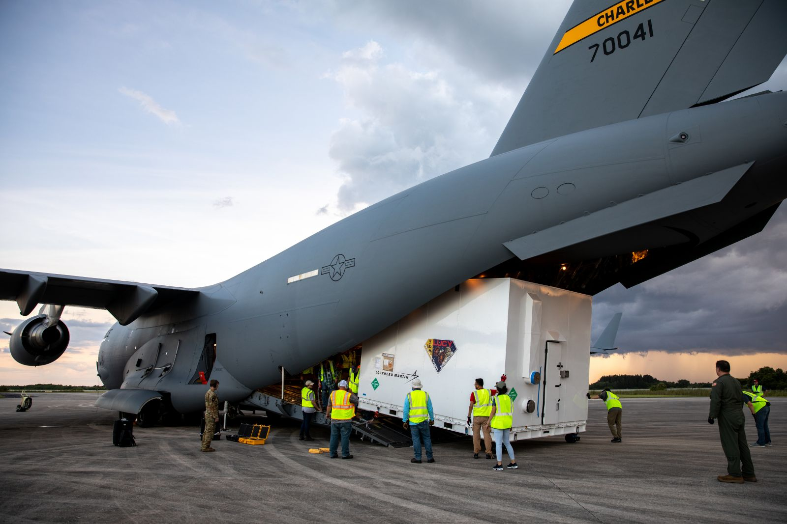 NASA's Lucy Trojan asteroid mission spacecraft is offloaded from a U.S. Air Force C-17 cargo plane after it arrives at Kennedy Space Center in Florida. Credit: NASA