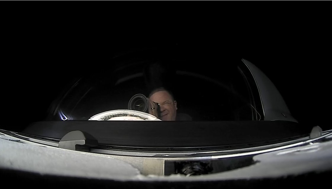 Mission Specialist Chris Sembroski takes a picture inside the Cupola window. Credit: SpaceX