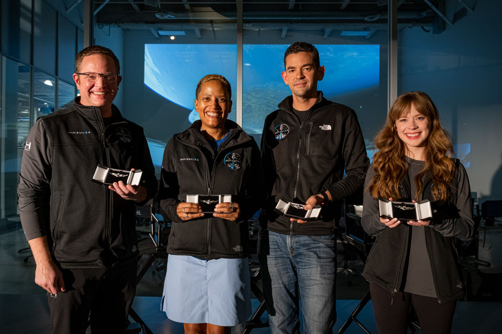 """The Inspiration4 crew receives their """"Dragon wings"""" during a post-flight event at SpaceX headquarters in Hawthorne, California. Credit: Inspiration4 / John Kraus"""