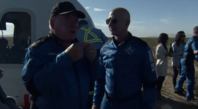 Shatner, overcome with emotion, discusses his trip into space with Jeff Bezos. Credit: Blue Origin