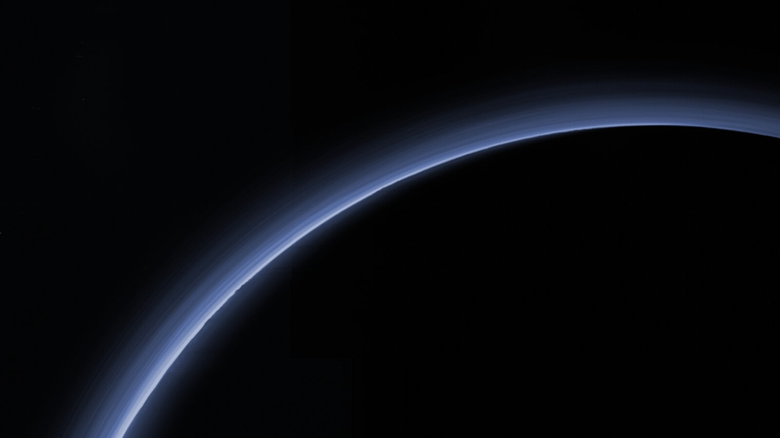 Pluto's atmosphere backlit by the Sun, photographed by New Horizons as it departed the Pluto system. Credit: NASA/JHU-APL/SwRI